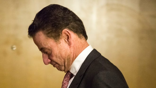 Louisville basketball coach Rick Pitino makes his way out from the NCAA hearing Thursday in Cincinatti's Westin Hotel. April 20, 2017