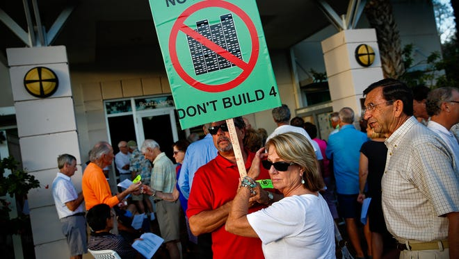 Pelican Landing residents David and Pam Spellerberg, center, were among the scores of residents that filled Bonita Springs City Hall on Feb. 3, 2016, opposing plans for construction of high rise towers on land annexed into the city.