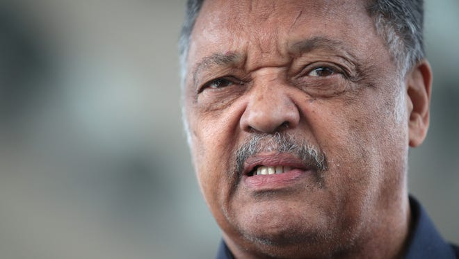 Civil rights leader Reverend Jesse Jackson leads a small group from the Rainbow PUSH Coalition in a protest outside the United Airlines terminal at O'Hare International Airport on April 12, 2017 in Chicago.
