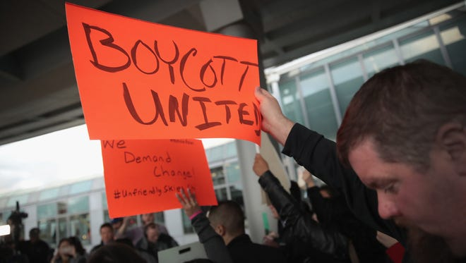 Demonstrators protest outside the United Airlines terminal at O'Hare International Airport on April 11, 2017 in Chicago, Illinois.