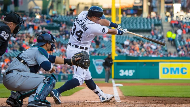 Detroit's  James McCann  hits a three run homer in the second inning against the Seattle Mariners during a MLB game at Comerica Park on April 25, 2017 in Detroit, Michigan.