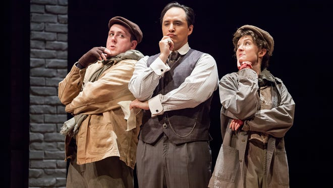 """A pair of messenger boys – Brian Owen, left, and Nisi Sturgis, right, are seen with Sherlock Holmes (Rafael Untalan, center) in the Cincinnati Playhouse's production of """"Ken Ludwig's Baskerville: A Sherlock Holmes Mystery."""""""