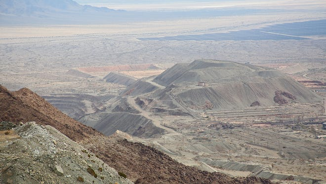 Looking down from the observation tower at the old Eagle Mountain iron mine, one can see the ghost town of Eagle Mountain, center right, one of the mining pits, center left, and the 550-megawatt Desert Sunlight solar farm, upper right.