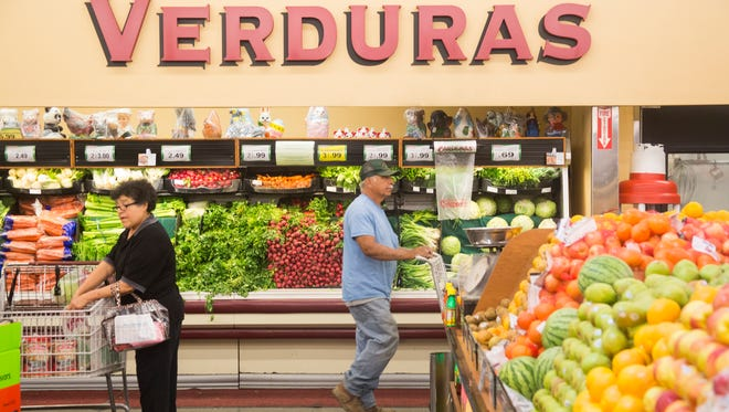 Shoppers at Cardenas Market in Coachella on April 27, 2017. The store has signs in Spanish throughout, allowing people with limited English skills to use their native language as they shop.