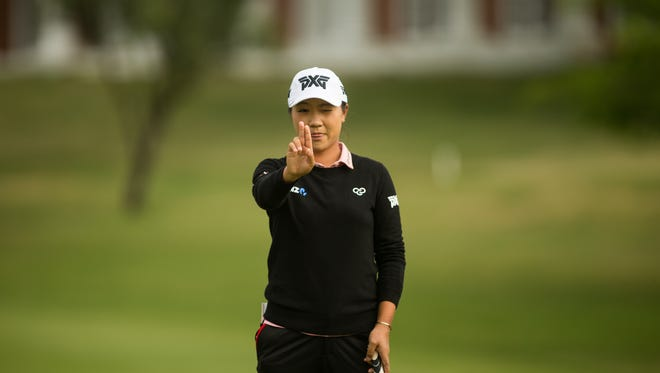Lydia Ko of New Zealand lines up a putt at the third hole during the first round of the Volunteers of America North Texas Shootout at Las Colinas Country Club on April 27 in Irving, Texas.