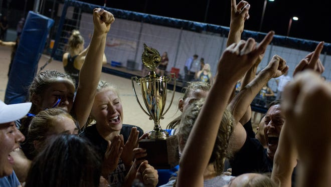 Fountain Hills High School celebrates after winning the div. II beach volleyball high school state final against Trivium Preparatory Academy at Mesquite High School in Gilbert, Ariz., on Wednesday, May 3, 2017.