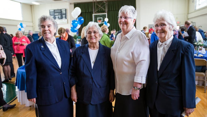 From left, Sisters Linda O'Rourke, Mary Rose DeDonato, Ellen Reilly, Fredrica Dunn during a reception at St. Thomas Aquinas School honoring their contributions to Lourdes Hospital as Daughters of Charity.