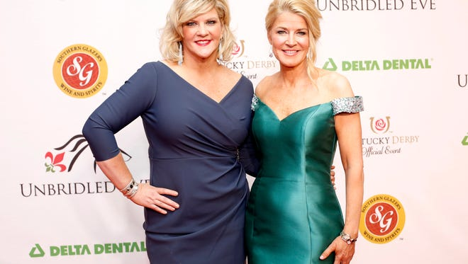 Hosts of the Unbridled Eve Derby Gala, Tammy York-Day, left, and Tonya York-Dees walk the red carpet at the 6th annual Unbridled Eve Derby Gala at the Galt House Hotel Grand Ballroom. May 5, 2017