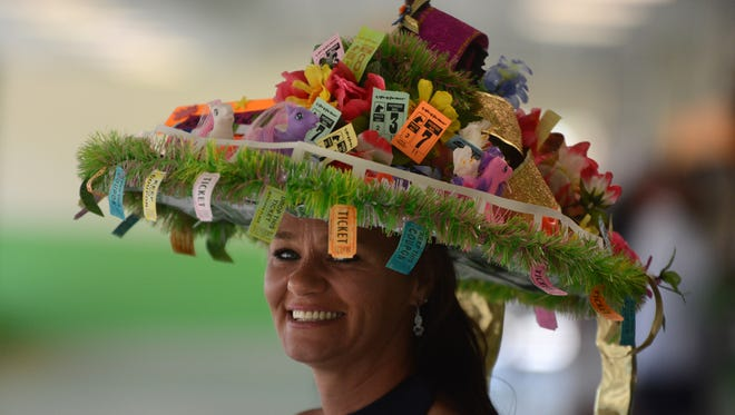 Overall winner Desiree Janeda wears a hat with a horse racing theme, designed by David Ascroft. The Naples-Fort Myers Greyhound Racing track in Bonita Springs hosted a fanciful hat competition Saturday, on the occasion of the Kentucky Derby, with a $1,000 gift certificate as the grand prize.