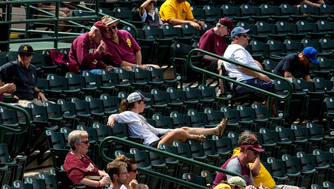Fans watch the Arizona State University baseball series finale against Stanford at Phoenix Municipal Stadium, in Phoenix, Ariz., on May, 7, 2017.