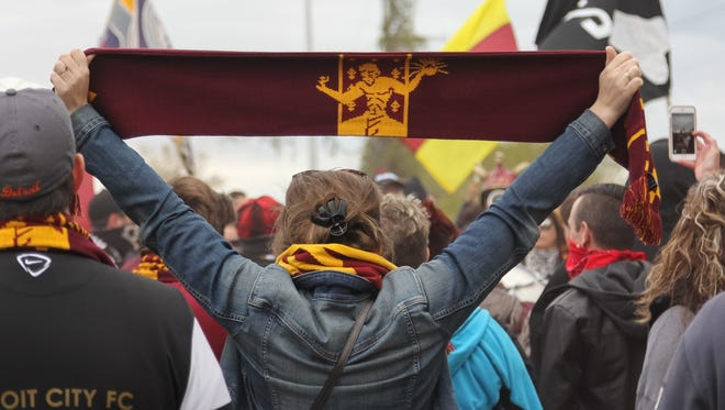 Fans gather for a brief pep rally on Conant Street before the march to Keyworth Stadium for the first home game of the season for Detroit City FC on Saturday, May 6, 2017.