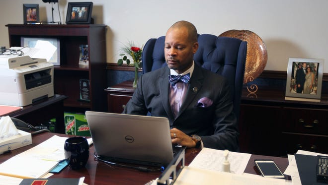 In this Monday, Feb 6, 2017, file photo, Senate Majority Leader Aaron Ford D-Las Vegas settles into his new office on opening day of the Legislative Session. at the State Capital in Carson City, Nev. Following the defeat of a federal internet privacy rule, Nevada's Senate leader is pushing to mandate websites disclose what types of personal information they collect from Nevadans. Ford on Thursday, May 11, 2017, introduced emergency legislation that would require all commercial websites, like Facebook, and internet connection providers, such as Comcast, to notify consumers of categories of identifying information they amass.