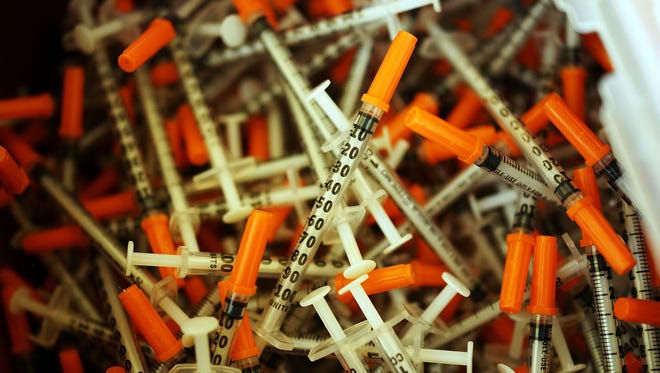 Used syringes are discarded at a needle exchange clinic where users can pick up new syringes and other clean items for those dependent on heroin.