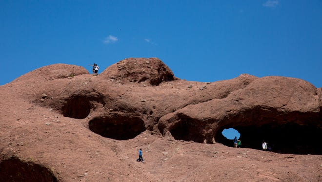 People hike Hole in the Rock at Papago Park in Phoenix on May 16, 2017.