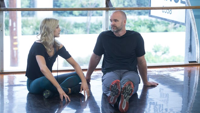 """Tallahassee's David Ross and partner Lindsay Arnold practice their dances for the finale of 'Dancing With the Stars,"""" which will air in two parts Monday and Tuesday."""