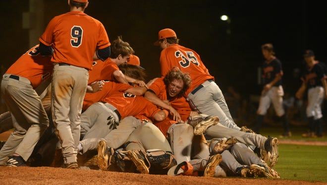 """The entire Beech team dogpiles in the middle of the field after successfully """"beating the curse"""" and getting the Bucs back in the state tournament for the first time in 35 years."""