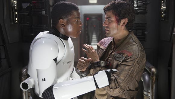 Finn (John Boyega) and Poe Dameron (Oscar Isaac) become