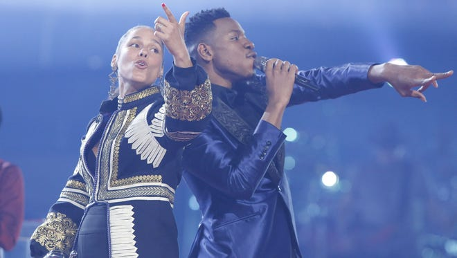 'The Voice' winner Chris Blue, right, sings with his coach, Alicia Keys, on the Season 12 finale of 'The Voice.'