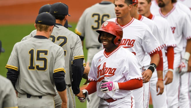 Michigan and Indiana players shake hands after the Hoosiers' 13-inning victory in the Big Ten baseball tournament.