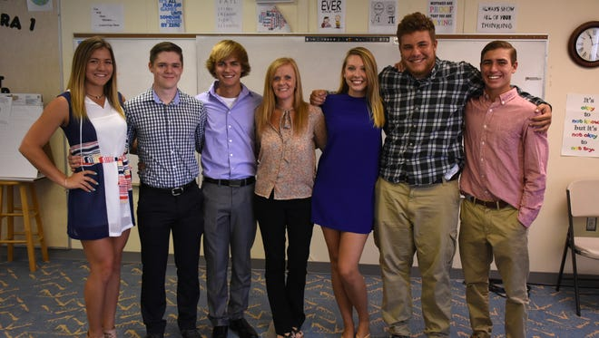 MIA principal Melissa Scott, center, with Olivia Scarpelli, Dylan Denkovich, Keaton Williams, Caitlyn Schmidt, Kyle Ginther, and Will Carlisle. Marco Island Academy showcases a few of its outstanding graduates.