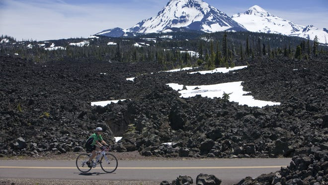The Mckenzie Pass Scenic Bikeway takes riders past lava fields and views of the Three Sisters.