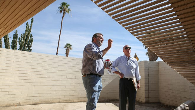 Mayor Pro Tem Sabby Jonathan, right, and  Public Works Director Mark Greenwood inspect the Miles Bates house in Palm Desert, June 7, 2017.   The home is mid-century modern with a unique wave-shaped roof. An effort is under way by the Historical Society of Palm Desert to get the house listed as a historical landmark while the city also finds ways to preserve its unique design.