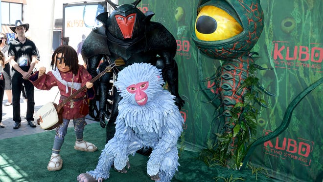 Characters from the film attend the premiere of Focus Features' 'Kubo and the Two Strings' at AMC Universal City Walk on August 14, 2016 in Universal City, California.