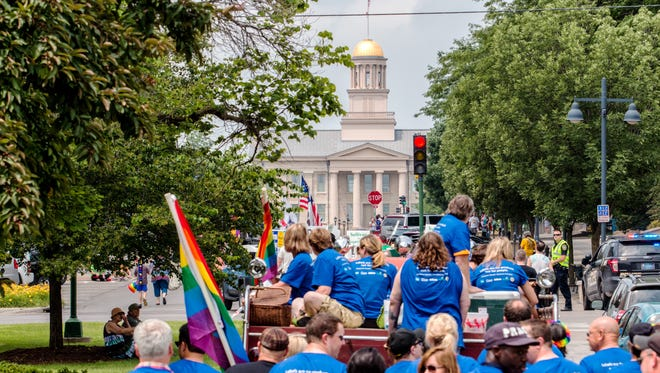 Parade participants make their way down Iowa Ave during the annual Iowa City Pride Parade in the downtown area on Saturday, June 20, 2015. The parade and street festival is part of the 45th IC Pride Week that celebrates acceptance and diversity.