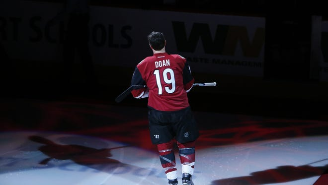 Shane Doan is recognized for his 1,500th NHL game and 400th goal before a game in January.