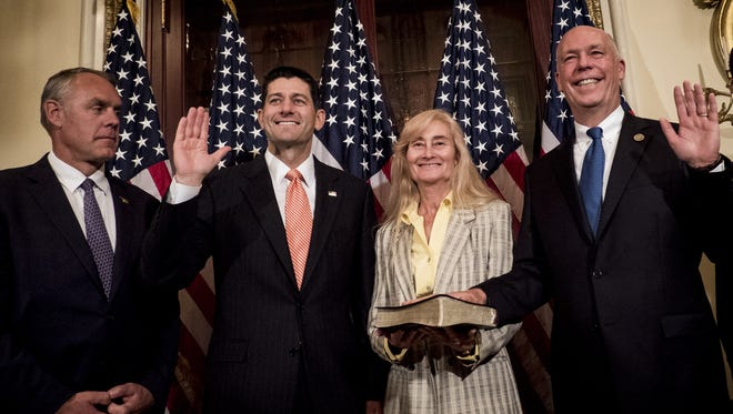 WASHINGTON, DC - JUNE 21:  Interior Secretary Ryan Zinke looks on as Speaker of the House Paul Ryan, R-Wis., performs a ceremonial swearing in of Montana Republican Greg Gianforte as his wife holds the bible on June 21, 2017 in Washington, DC. Gianforte won a May 25 special election to serve out the remaining 18 months of the term vacated by now-Interior Secretary Zinke.  (Photo by Pete Marovich/Getty Images) ORG XMIT: 700069129 ORIG FILE ID: 699417974