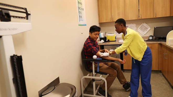 Peter Yanez, insured through the Affordable Care Act, receives a blood test.