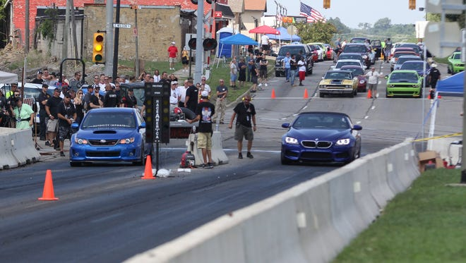 """Amateur drag racers competed on a closed section of Woodward Ave during """"Roadkill Nights Powered by Dodge"""" at the M1 Concourse in Pontiac, MI, on Friday, August 19, 2016. The event returns this year on Aug. 12, 2017."""