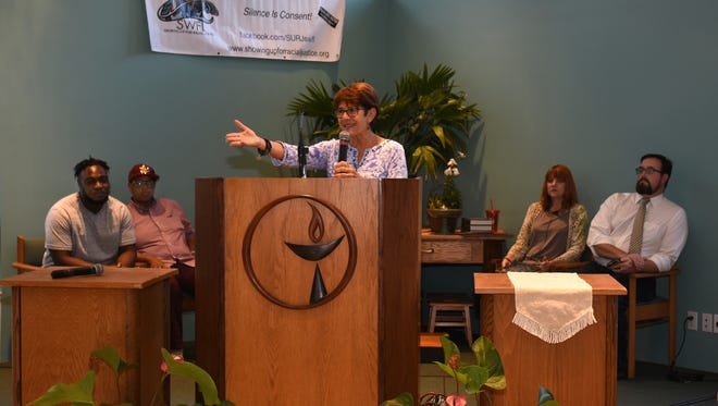 Flanked by the speakers, Cynthia Odierna welcomes attendees to the meeting. The SWFL Justice4All Coalition sponsored a forum focusing on racism and social injustice at the Moral Monday meetup on July 3 at the Unitarian Universalist congregation in Naples.