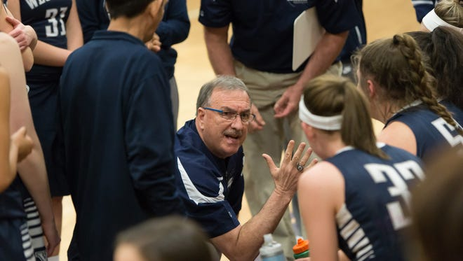 West York coach Darrell Wildasin talks to his team during a timeout against Greencastle-Antrim during a District 3 Class 5A girls basketball game on Tuesday, February 21, 2017. The Bulldogs won, 43-38.