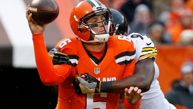 Cleveland Browns quarterback Cody Kessler is sacked by Pittsburgh Steelers inside linebacker Lawrence Timmons before he can get off a pass during the first half of a game in Cleveland on Nov. 20, 2016.