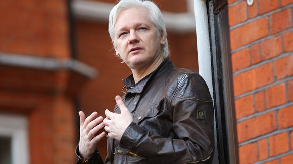 Julian Assange, founder of Wikileaks, speaks to the media from the balcony of the Embassy Of Ecuador on May 19, 2017 in London, England.