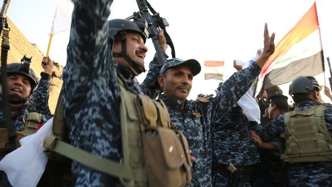Iraqi soldiers attend a celebration for the liberation of Mosul in Mosul, Iraq, July 10, 2017. Haider al-Abadi on Monday formally declared Mosul liberated from Islamic State (IS) militant group after nine months of fierce fighting to dislodge the extremist militants from their last major stronghold in Iraq. (CKhalil Dawood/Xinhua/Zuma Press/TNS)