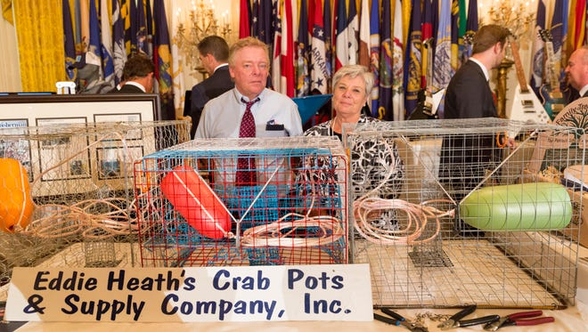 Eddie and Sue Heath of Eddie Heath's Crab Pots and Supply Company Inc. of Crisfield display their products at the Made in America Product Showcase on Monday in the East Room at the White House in Washington.