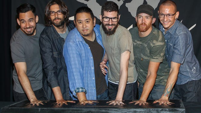 Members of Linkin Park in June 2014, from left, Mike Shinoda, Rob Bourdon, Joe Hahn, Brad Delson, Dave Farrell and Chester Bennington.