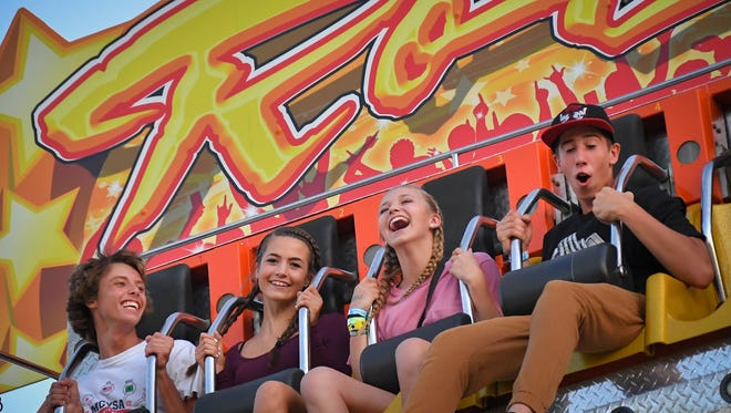 Midway rides brought smiles to the riders' faces at the Winnebago County Fair last year at the Sunnyview Expo Center. This year's fair runs Aug. 2 through 6.