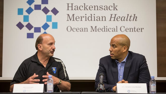 Ocean County Prosecutor Joe Coronato and Sen. Cory Booker (D-NJ) attend a roundtable discussion at Ocean Medical Center with Ocean County Prosecutor Joe Coronato, the DEA and health care professionals to discuss the opioid crisis. Brick, NJSaturday, July 29, 2017@dhoodhood