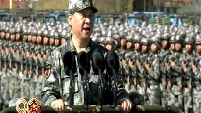 In this image taken from video, Chinese President Xi Jinping inspects troops of the People's Liberation Army (PLA) Sunday, July 30, 2017 during a military parade to commemorate the 90th anniversary of the founding of the PLA on Aug. 1 at Zhurihe training base in north China's Inner Mongolia Autonomous Region. (CCTV via AP Video)