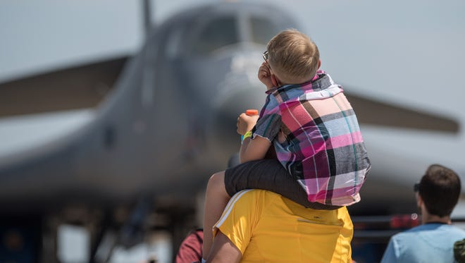 Julian John Rodriguez, 8, and father Jesse watch the air show in front of the B-1 bomber. EAA AirVenture 2017 wrapped up on Sunday, July 30, 2017.
