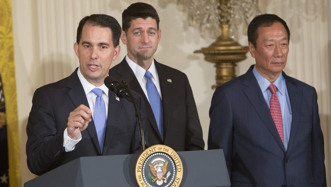 Gov. Scott Walker speaks during the announcement at the White House in Washington, D.C., about the creation of a Foxconn factory in Wisconsin to build LCD flat screen monitors. With Walker is House Speaker Paul Ryan (center) (R-Wis.)  and Foxconn founder and Chairman Terry Gou.