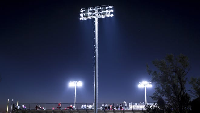 Stadium lights illuminate the Scottsdale sky above Notre Dame Prep's football stadium during a game between Paradise Valley and Notre Dame Prep on Oct. 6, 2016.