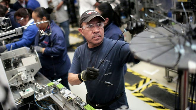Employees work in the auto parts production line in the Bosch factory in San Luis Potosi, Mexico, on Jan. 11, 2017.