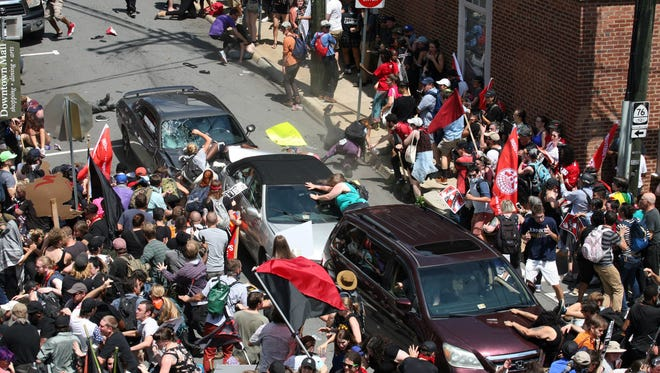 A gray car plows into pedestrians and vehicles on the mall in Charlottesville, Va., after Saturday's white supremacist rally, killing one and injuring 19.