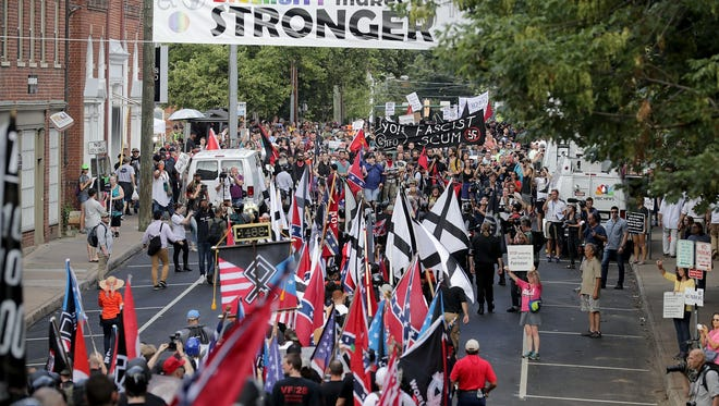 """830755838.jpg CHARLOTTESVILLE, VA - AUGUST 12:  Hundreds of white nationalists, neo-Nazis and members of the """"alt-right"""" march down East Market Street toward Lee Park during the """"United the Right"""" rally August 12, 2017 in Charlottesville, Virginia. After clashes with anti-facist protesters and police the rally was declared an unlawful gathering and people were forced out of Lee Park, where a statue of Confederate General Robert E. Lee is slated to be removed.  (Photo by Chip Somodevilla/Getty Images)"""