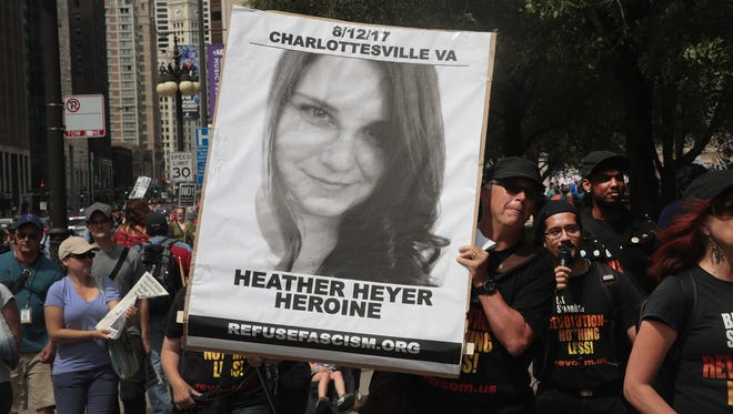 A demonstrator carries a sign remembering Heather Heyer during a protest in Chicago, Illinois.