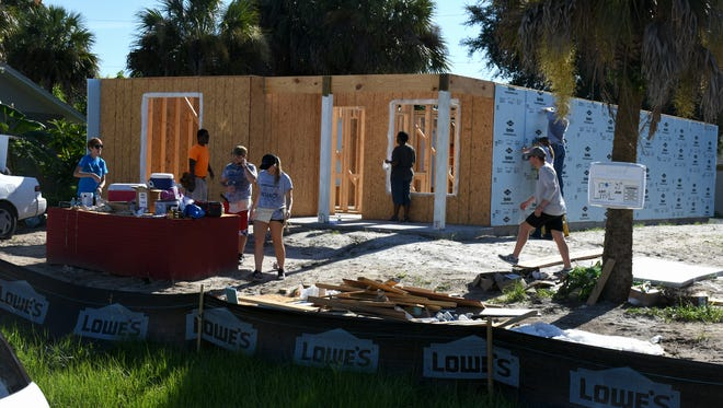 First-year law students at Ave Maria School of Law helped build houses at several Habitat for Humanity locations on Aug. 12, 2017, in a service project and team-building exercise.